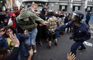 http://ca.news.yahoo.com/photos/anti-austerity-protests-in-spain-slideshow/policeman-clubs-protester-police-charged-demonstrators-outside-spanish-photo-175854650.html