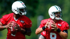 Geno Smith (left) beats out Mark Sanchez (right) for the Jets starting job.