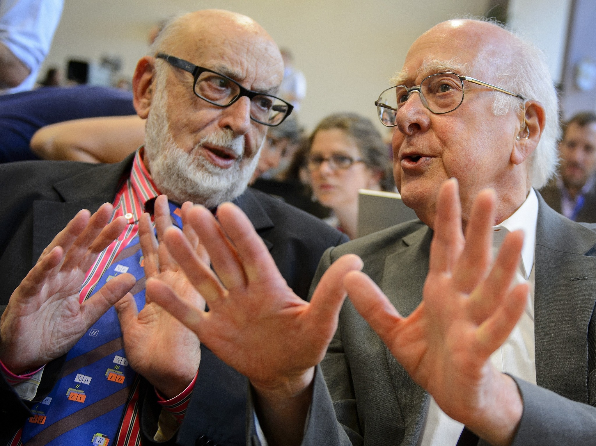Francois Englert (left) and Peter Higgs discuss their discovery during a press conference at CERN offices. AFP/Getty Images