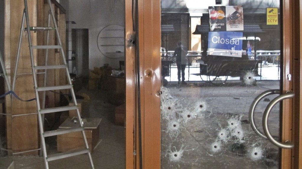Bullet holes in the glass door of a shop in the Westgate Mall in Nairobi, Kenya. Photo by Associated Press.