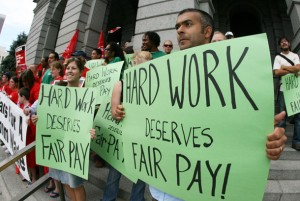 Protestors speak out against minimum wage.