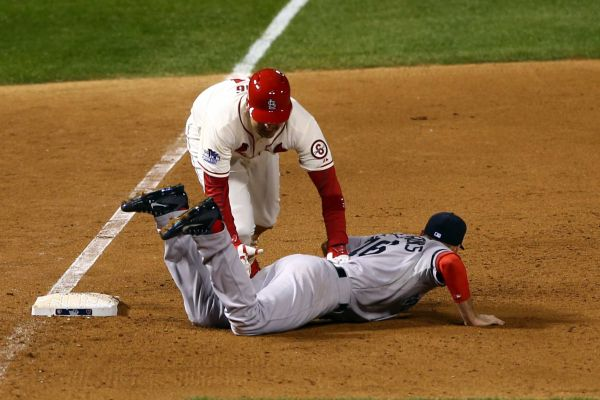 Allen Craig trips over Will Middlebrooks' legs for a walk-off obstruction call. Media by www.newsday.com