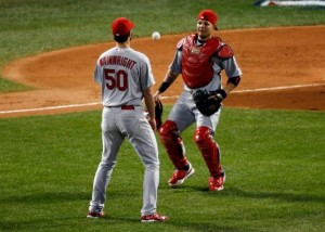 Adam Wainwright and Yadier Molina watch a pop up drop between them. Media by www.nydailynews.com