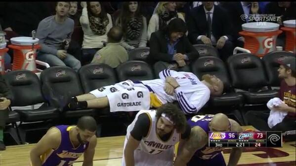 After fouling out Center Chris Kaman lays out along Lakers empty bench Media by diehardsport.com