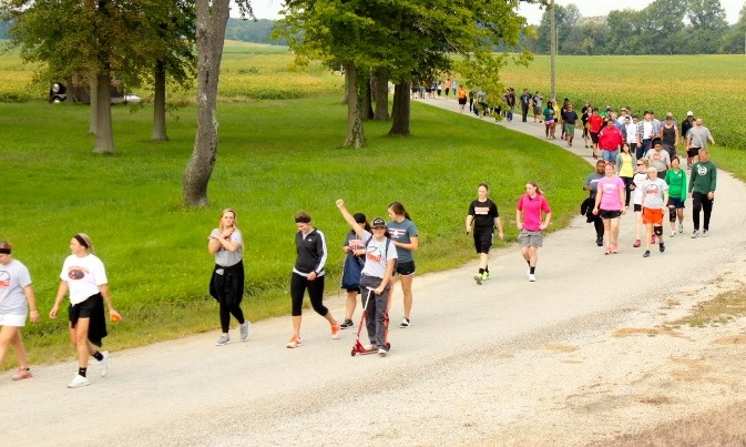Students walking along the 5.5 mile route to Durley Camp. Photo provided by Greenville College Student Associations