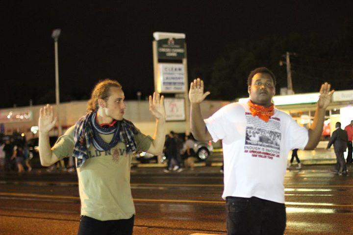 Hands up as night falls. Media from Andrea Freeman.
