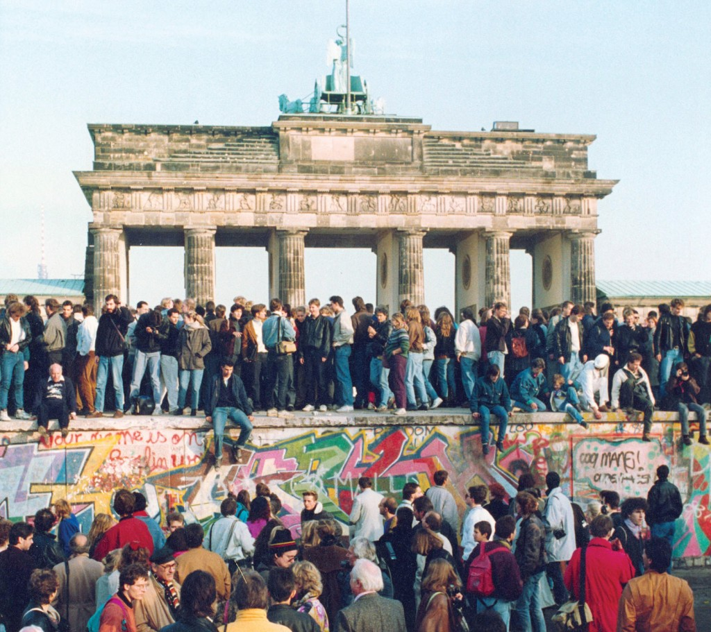People gathering around Berlin Wall when it fell on Nov. 9th, 1989. Source: www.britannica.com
