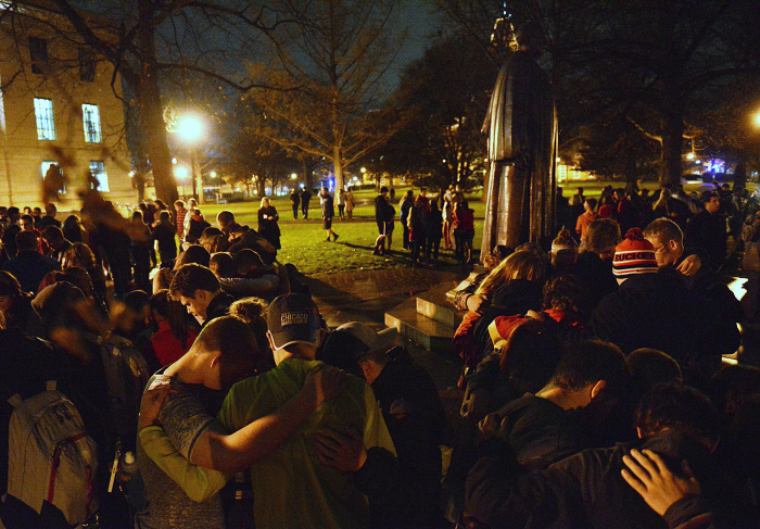 Students praying for Kosta Karageorge. Source: www.dispatch.com
