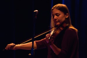 Abby Gundersen plays the violin for her brother Noah