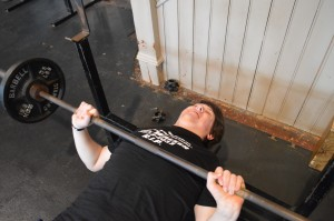 Jacob Siefken struggling with the bench-press.