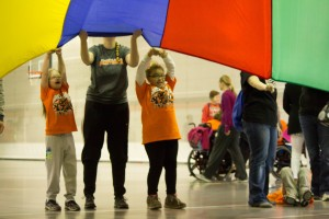 The colorful parachute game. Photo by GC Marketing