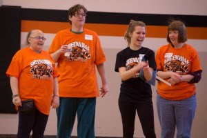 Volunteer cheering for the special olympic athletes. Photo by Greenville College Marketing