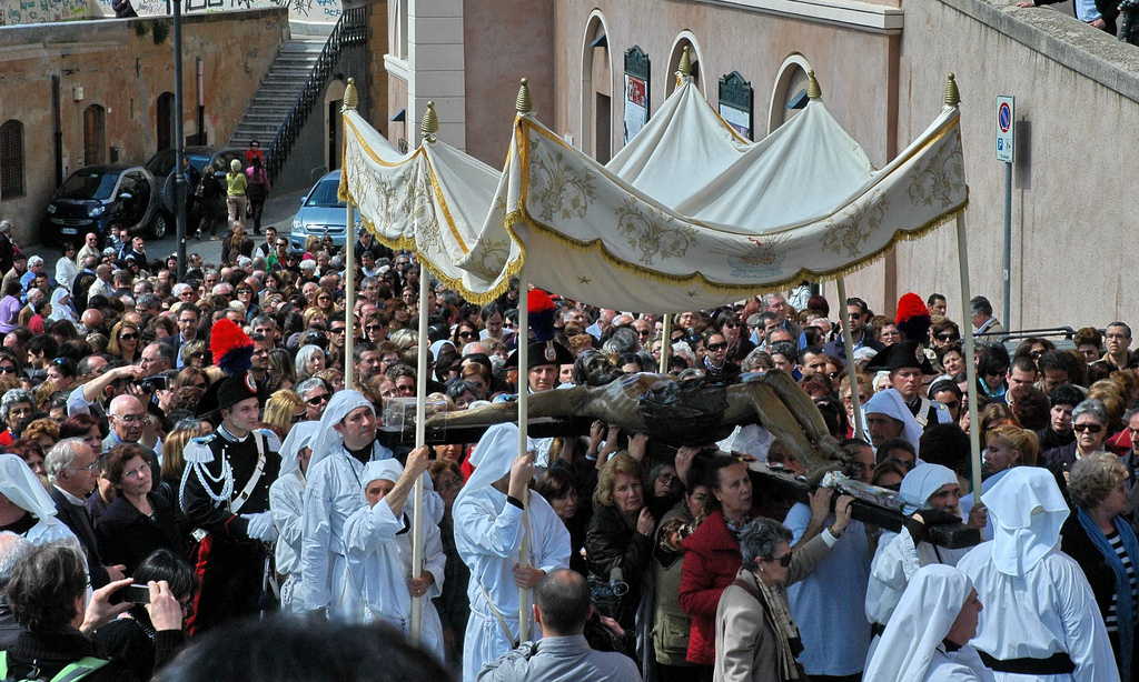 Jesus on the cross being carried during a procession through the streets during Easter week. Source:http://www.italymagazine.com/featured-story/holy-week-sardinia