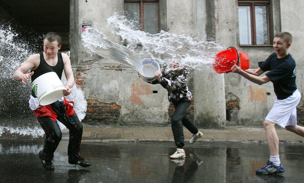 "Young boys participating ""Wet Monday"" to celebrate Easter. Source:http://culture.pl/en/article/polish-easter-traditions"