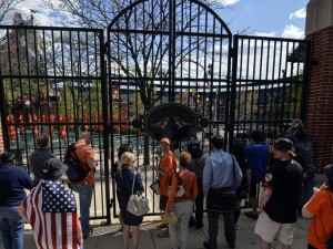 Image from USA today sports. Some die hard Baltimore fans watch from outside the locked gate