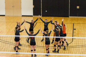 The Greenville College Women's volleyball team prepares for the 2015 season.  Photo by Laurie Hannula