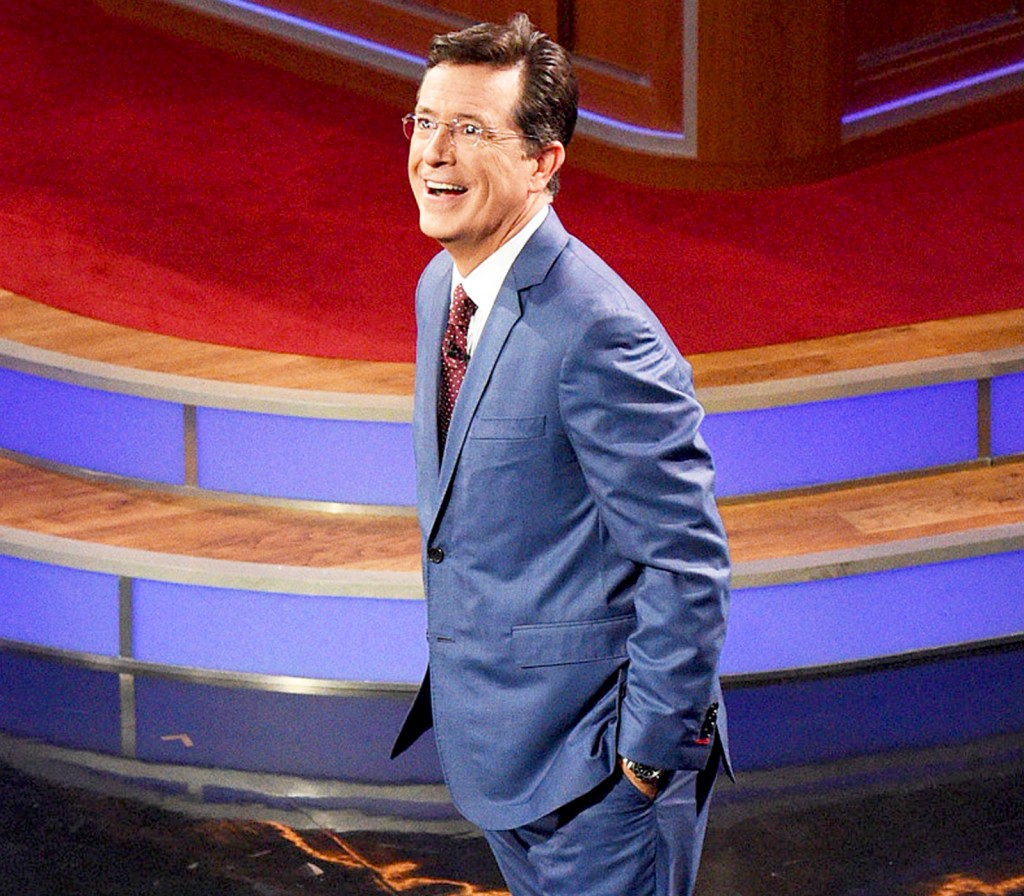 Colbert looking at the crowd in amazement on his first show via usmagazine.com