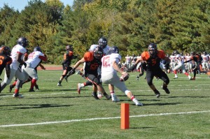 Lincoln Johnson (7) and Robert Deering (56) look to get the tackle.  Photo by Greenville College Football.
