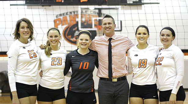 Greenville Women's Volleyball Senior posing for a picture with their coach. Image by Bilinski Bros.