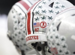 An Ohio State helmet on the sidelines before the start of their game against Michigan State with a special decal paying tribute to Chad Carr Saturday, Nov. 21, 2015.