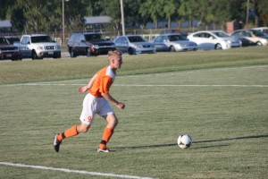 Action shot picture of Jacob Jones in his freshmen year of soccer. Also, has a  mo-hawk hair style.