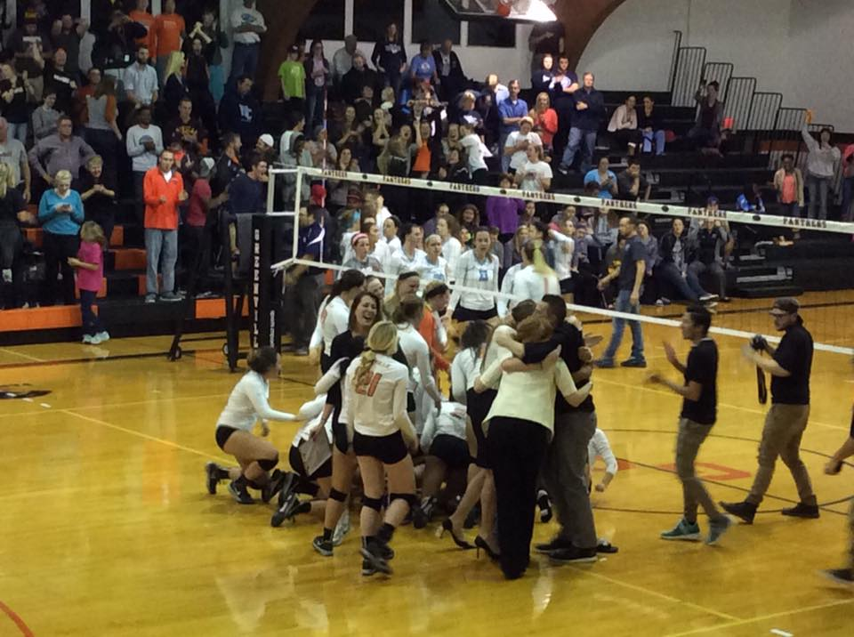 The GC Volleyball team storms the court after winning the SLIAC championship.  Photo by GC Papyrus.