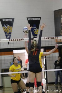 Riley Hannula goes for the block during the SLIAC tournament.  Photo by Bilinski Bros.