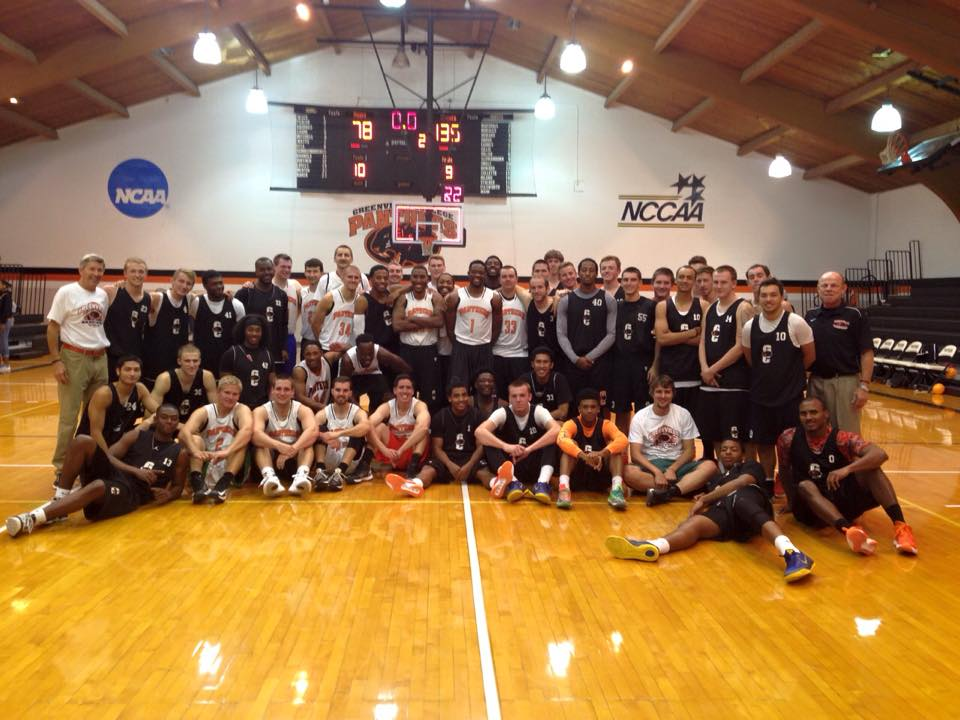 Greenville Men's Basketball team with the Alumni. Image by Greenville Men's Basketball Facebook Page.