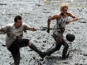 Soccer being played at the Mud Olympics, Image from telegraph.co.uk