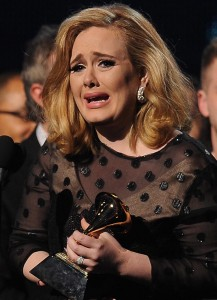 Adele crying at the 54th Grammy Awards.
