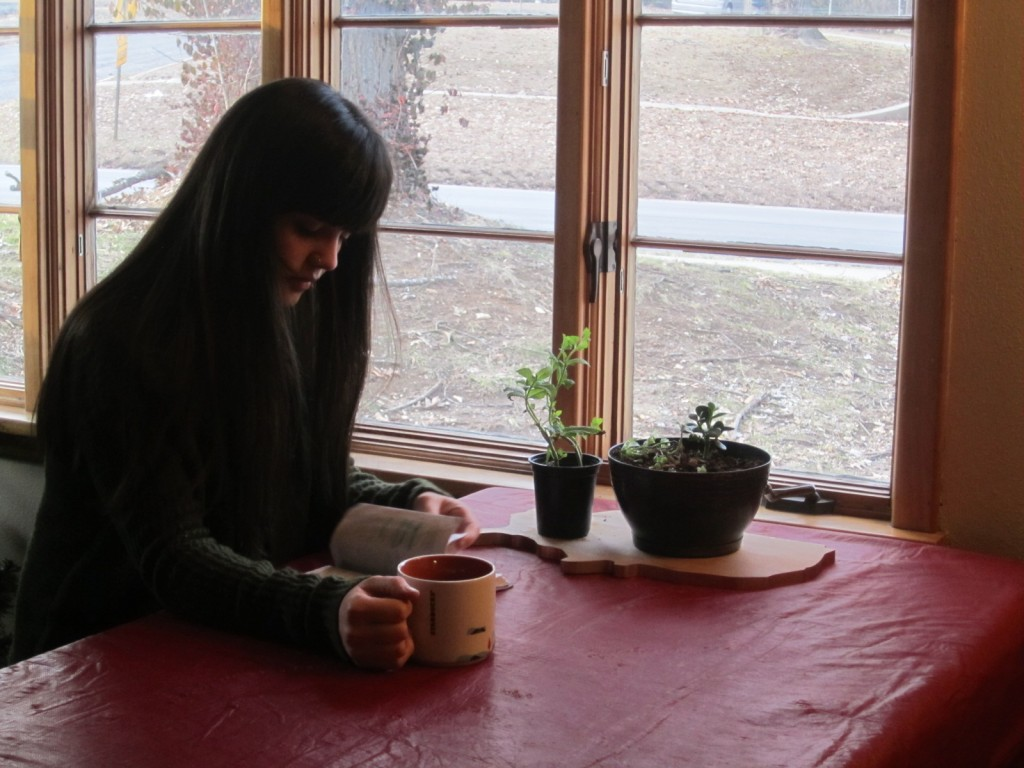 A student sits drinking coffee.