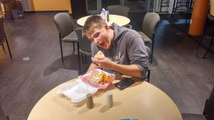 Student Andrew Anderson relishes his quesadilla. Photo by Ben Casey.