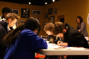 Students writing letters to the Governer
