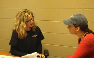 Kelli Pryor meets with a student to discuss their resume.