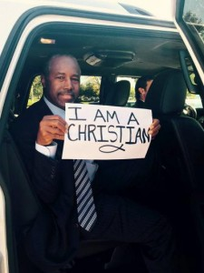 Ben Carson holding I am a Christian Sign