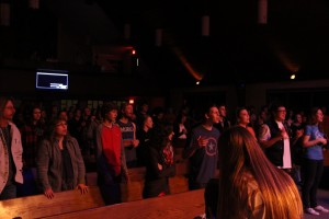 Students sing in worship