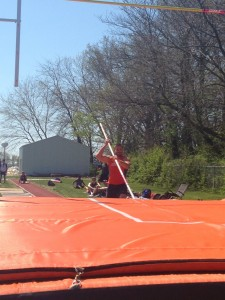 Phil Wisman running down the pole vault lane and about to jump. Image by Austin Brinkman