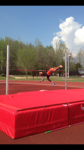 Treyvon Manning going up in high jump. Image by Austin Brinkman