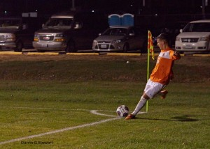 Edgar Bueno sending in a corner kick. greenville.edu