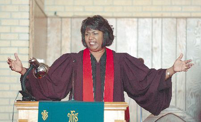 Reverend Cheryl Penson preaching at Lane Chapel Christian Methodist Episcopal Church. Image by: rollingout.com