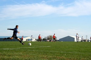 Jonathan taking a goal kick. Greenville Men's Soccer
