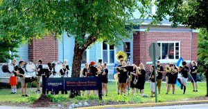 Greenville College Marching band plays as students gather outside of Whitlock
