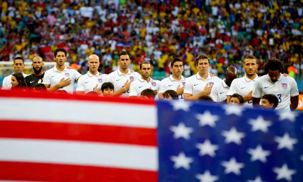 The USA starting XI sing their national anthem