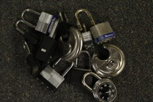 A pile of various padlocks