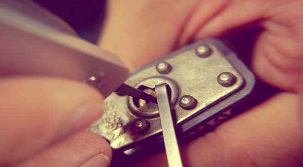A padlock being picked open