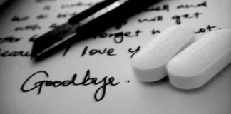 Suicide note, pen, and pills