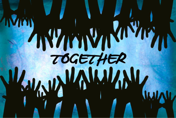 hands reaching the word together