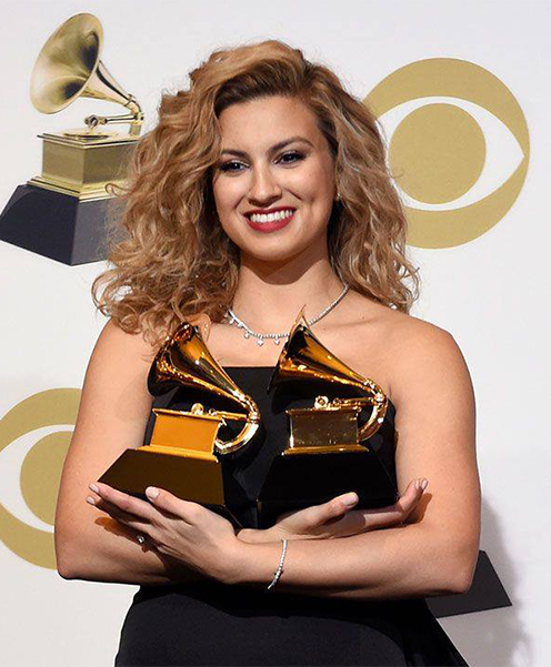 Tori Kelly holding both GRAMMY trophies
