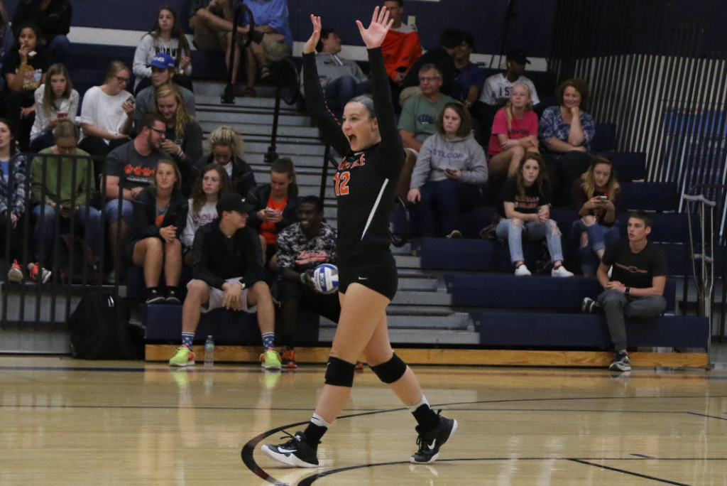 Allyson Grabowski raising her hands in celebration during a match.