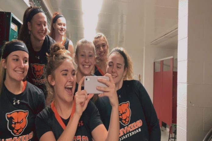 A few of the women's basketball players in a fun mirror photo.